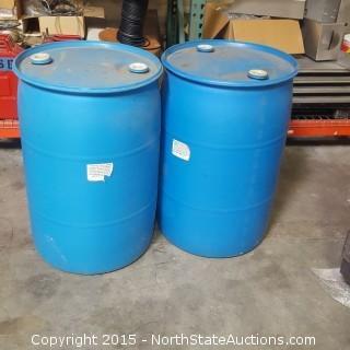 Two Plastic 55 Gallon Barrels