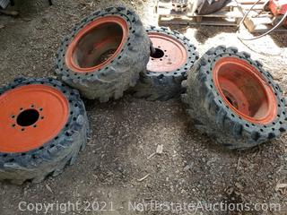 Set Of Bobcat Tires And Rims