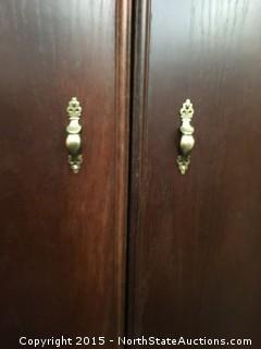 Dark wood armoire