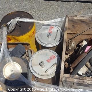 3 55-Gallon Barrels and 5 Gallon Jugs