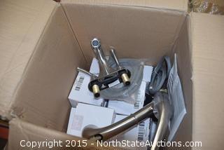 Box of Moen Faucets