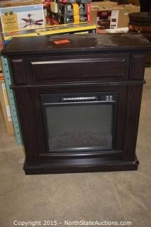 Electric Stove in wood mantle